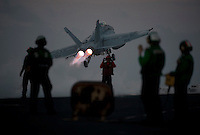 111221-N-DR144-375 PACIFIC OCEAN (Dec. 21, 2011)  An F/A-18F Super Hornet assigned to Strike Fighter Squadron (VFA) 22 launches from the flight deck of Nimitz-class aircraft carrier USS Carl Vinson (CVN 70). Carl Vinson and Carrier Air Wing (CVW) 17 are currently underway on a Western Pacific deployment.  (U.S. Navy photo by Mass Communication Specialist 2nd Class James R. Evans/Released).