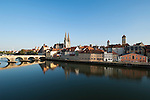Germany, Bavaria, Upper Palatinate, Regensburg at river Danube: Old Town with Stone Bridge, City Gate, Cathedral St. Peter and Clock Tower of the Old Cityhall