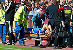Hearts v St Johnstone...14.08.10  .Danny Grainger is stretchered off after injuring his knee.Picture by Graeme Hart..Copyright Perthshire Picture Agency.Tel: 01738 623350  Mobile: 07990 594431