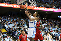 CHAPEL HILL, NC - NOVEMBER 01: Armando Bacot #5 of the University of North Carolina is fouled by Justin Ross #11 of Winston-Salem State University during a game between Winston-Salem State University and University of North Carolina at Dean E. Smith Center on November 01, 2019 in Chapel Hill, North Carolina.