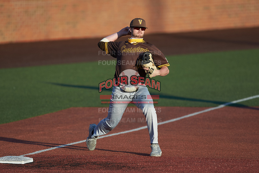 Valparaiso Crusaders third baseman Kaleb Hannahs (15) makes a throw to first base against the Western Kentucky Hilltoppers at Nick Denes Field on March 19, 2021 in Bowling Green, Kentucky. (Brian Westerholt/Four Seam Images)