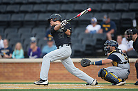 Bruce Steel (17) of the Wake Forest Demon Deacons follows through on his swing against the West Virginia Mountaineers in Game Six of the Winston-Salem Regional in the 2017 College World Series at David F. Couch Ballpark on June 4, 2017 in Winston-Salem, North Carolina.  The Demon Deacons defeated the Mountaineers 12-8.  (Brian Westerholt/Four Seam Images)