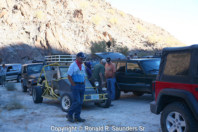 Off road stranded drivers halt among boulders