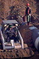Saburtalo, Georgia, 07/12/2004..Construction work at pump station on the BTC pipline..Filling in ground over the pipeline which leads out of the pumping station to Turkey.....