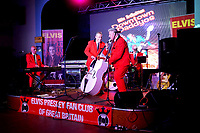 BNPS.co.uk (01202 558833)<br /> Pic: ElvisPresleyFanClubOfGB/BNPS<br /> <br /> Pictured: A performance at the Annual Elvis Week event near Great Yarmouth, Norfolk, in 2019, held every year.<br /> <br /> One of the world's most renowned Elvis Presley fan clubs is expected to sell for a staggering £100,000.<br /> <br /> The Official Elvis Presley Fan Club of Great Britain was established in London in 1957 and has a membership of almost 5,000 people over 60 years on.<br /> <br /> The current president, Todd Slaughter, bought it in 1967 after working as a journalist on music magazines.