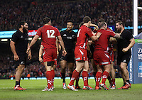 Pictured: A fight breaks out between Dane Coles (R) of New Zealand and Wales players Saturday 22 November 2014<br />
