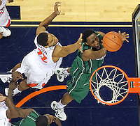 CHARLOTTESVILLE, VA- NOVEMBER 26:  Greg Mays #15 of the Green Bay Phoenix shoots in front of Malcolm Brogdon #22 of the Virginia Cavaliers during the game on November 26, 2011 at the John Paul Jones Arena in Charlottesville, Virginia. Virginia defeated Green Bay 68-42. (Photo by Andrew Shurtleff/Getty Images) *** Local Caption *** Greg Mays;Malcolm Brogdon