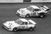 #17 Mazda RX-7 of Jim Mederer, Don Sherman, and Jeff Kline, 28th place, and #11 Porsche 935 of Bruce Canepa, Rick Mears, and Monte Shelton, 3rd place,  24 Hours of Daytona, Daytona International Speedway, Daytona Beach, FL, February 1979. (Photo by Brian Cleary/bcpix.com)