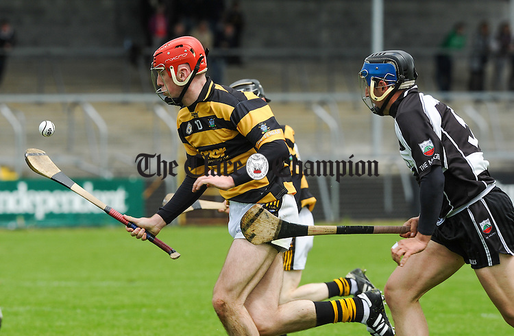 Donal Madden of Tubber in action against Adam Healy of Clarecastle during their game at Cusack park. Photograph by John Kelly.