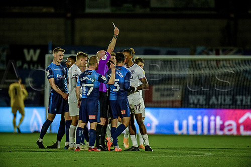 21st November 2020; Adams Park Stadium, Wycombe, Buckinghamshire, England; English Football League Championship Football, Wycombe Wanderers versus Brentford; Ivan Toney is yellow carded at the end of the game for an argument
