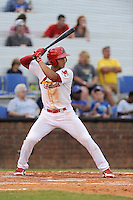 Second baseman Chris Rivera (11) of the Johnson City Cardinals bats in a game against the Elizabethton Twins on Sunday, July 27, 2014, at Howard Johnson Field at Cardinal Park in Johnson City, Tennessee. The game was suspended due to weather in the fifth inning. (Tom Priddy/Four Seam Images)