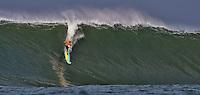 Half Moon Bay, California - January 24, 2014: 2014 Maverick's Invitational Kohl Christensen  making the drop.
