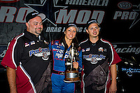 Sept. 18, 2011; Concord, NC, USA: NHRA pro mod driver Leah Pruett celebrates with crew members after winning the O'Reilly Auto Parts Nationals at zMax Dragway. Mandatory Credit: Mark J. Rebilas-