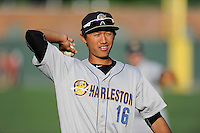 Second baseman Gosuke Katoh (16) of the Charleston RiverDogs warms up before a game against the Greenville Drive on Sunday, May 24, 2015, at Fluor Field at the West End in Greenville, South Carolina. Charleston won 3-2. (Tom Priddy/Four Seam Images)