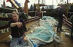 Fishing industry mending nets Fleetwood Lancashire  1980s