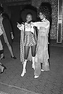 Manhattan, New York City, NY - March 8, 1971  <br /> Muhammad Ali and Joe Frazier at Madison Square Garden  - Billed as the 'Fight of the Century' African-American boxing fans and dandies attended wearing the most glam-fashions of the day. Furs, minis and thigh-high platform boots were all the rage.