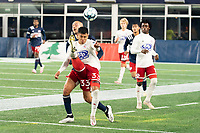 FOXBOROUGH, MA - OCTOBER 16: Edwin Cerrillo #33 of North Texas SC passes the ball backwards during a game between North Texas SC and New England Revolution II at Gillette Stadium on October 16, 2020 in Foxborough, Massachusetts.