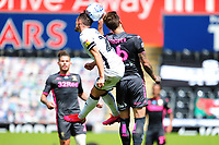 Connor Roberts of Swansea City battles with Liam Cooper of Leeds United during the Sky Bet Championship match between Swansea City and Leeds United at the Liberty Stadium in Swansea, Wales, UK. Sunday 12 July 2020