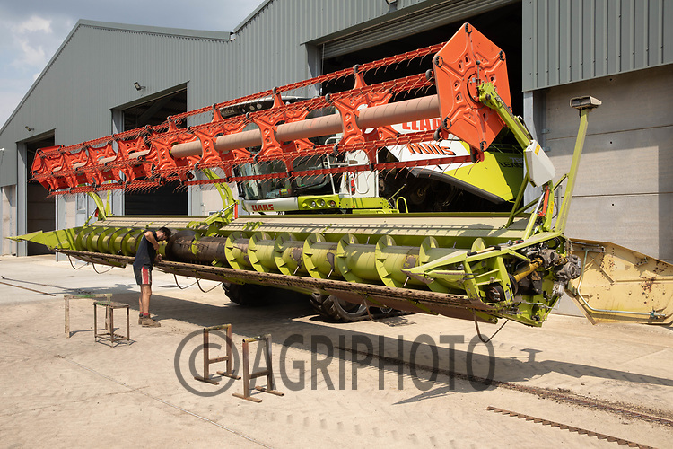 Checking a combine before the start of harvest<br /> ©Tim Scrivener Photographer 07850 303986<br />      ....Covering Agriculture In The UK....