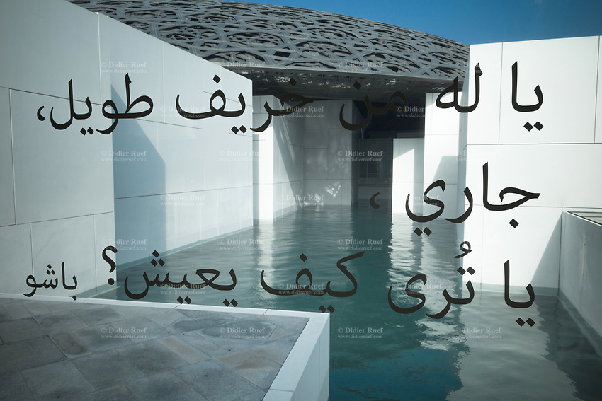 United Arab Emirates (UAE). Abu Dhabi.The Louvre Abu Dhabi is an art and civilization museum. Arabic writings on the glass window. The museum is part of a thirty-year agreement between the city of Abu Dhabi and the French government. The museum is located on the Saadiyat Island Cultural District. It is approximately 24,000 square metres in size, with 8,000 square meters of galleries, making it the largest art museum in the Arabian peninsula. Jean Nouvel (born 12 August 1945), a French architect, has conceived the Louvre Abu Dhabi. Now considered as one of the modern urban wonders of the world, Louvre Abu Dhabi is not only the Arab world's first universal museum but a powerful symbol of the United Arab Emirates' ambition and achievement. The centre piece of Nouvel's vision is a huge silvery dome that appears to float above the museum-city. Despite its apparent weightlessness, the dome weighs around 7,500 tonnes. Inspired by the cupola, a distinctive feature in Arabic architecture, Nouvel's dome is a complex, geometric structure of 7,850 stars. These stars are repeated at various sizes and angles in eight different layers. As the sun passes above, its light filters through the perforations in the dome to create an enchanting effect within the museum, known as the 'rain of light'.  The United Arab Emirates (UAE) is a country in Western Asia at the northeast end of the Arabian Peninsula. 21.02.2020  © 2020 Didier Ruef