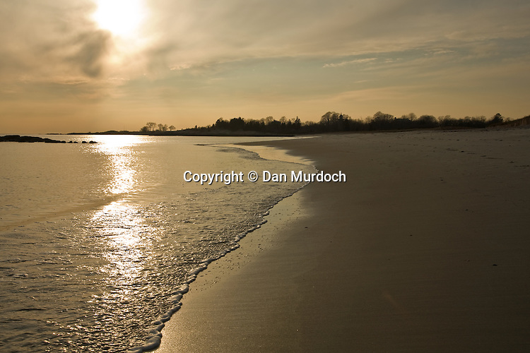 Setting sun on a quiet beach in Waterford, CT