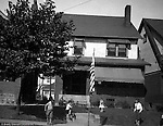 Wilkinsburg PA: View of Stewart's house with Brady Jr, Helen, Sally, and a friend playing in the front yard. Stewart's lived at 1007 East End Avenue in Wilkinsburg.  During the 1920s and 1930s, Wilkinsburg was a growing community for the emerging middle class of Pittsburgh.
