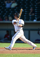 Mesa Solar Sox catcher Sean Ochinko (11) hits a home run during an Arizona Fall League game against the Surprise Saguaros on October 17, 2014 at Cubs Park in Mesa, Arizona.  Mesa defeated Mesa 5-3.  (Mike Janes/Four Seam Images)
