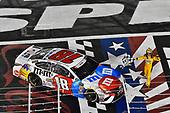 #18: Kyle Busch, Joe Gibbs Racing, Toyota Camry M&M's Red White & Blue celebrates his win