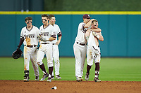 Hunter Stovall (13) of the Mississippi State Bulldogs gets a hug from a teammate following his walk-off sacrifice fly in the bottom of the 12th inning against the Houston Cougars in game six of the 2018 Shriners Hospitals for Children College Classic at Minute Maid Park on March 3, 2018 in Houston, Texas. The Bulldogs defeated the Cougars 3-2 in 12 innings. (Brian Westerholt/Four Seam Images)