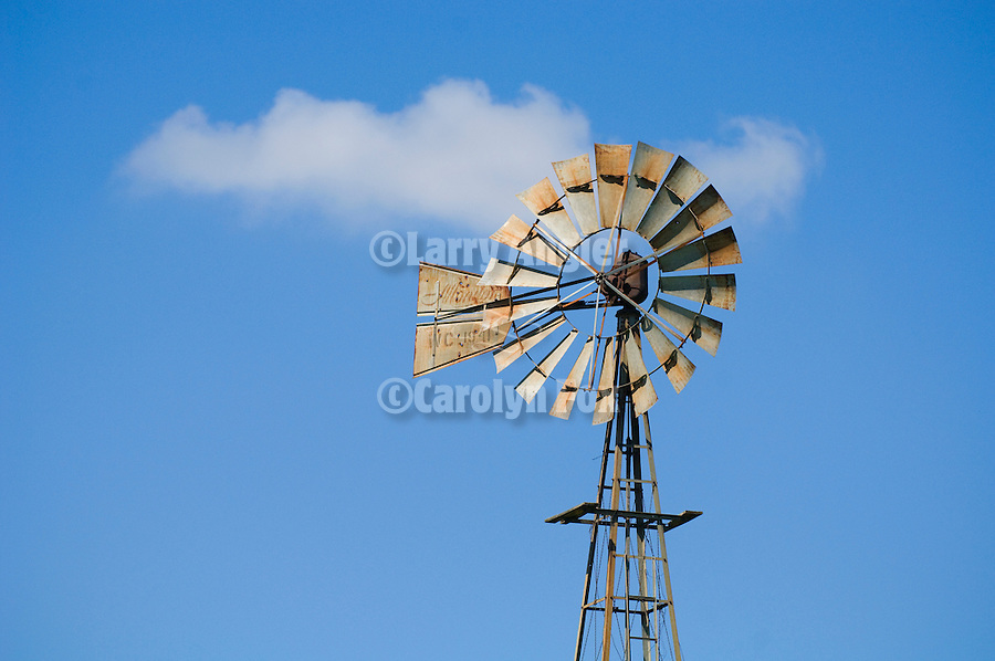 1941 Baker Monitor WC metal windmill on tower, clouds, Kansas.
