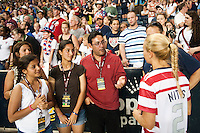 the Philadelphia Phillies general manager Ruben Amaro Jr talks with Heather Mitts (2) of the United States (USA) after the match. The United States (USA) women defeated China PR (CHN) 4-1 during an international friendly at PPL Park in Chester, PA, on May 27, 2012.