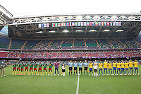 The teams line up before kick-off - Brazil Women vs Cameroon Women - Womens Olympic Football Tournament London 2012 Group E at the Millenium Stadium, Cardiff, Wales - 25/07/12 - MANDATORY CREDIT: Gavin Ellis/SHEKICKS/TGSPHOTO - Self billing applies where appropriate - 0845 094 6026 - contact@tgsphoto.co.uk - NO UNPAID USE.