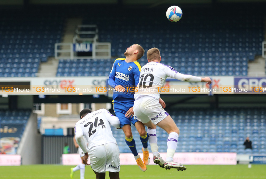 Shane McLoughlin of AFC Wimbledonheads the ball clear from Josh Vela of Shrewsbury Town during AFC Wimbledon vs Shrewsbury Town, Sky Bet EFL League 1 Football at The Kiyan Prince Foundation Stadium on 17th October 2020