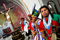"""Natives from the Kamentsá tribe, wearing colorful costumes, participate in the Catholic mass during the Carnival of Forgiveness, a traditional indigenous celebration in Sibundoy, Colombia, 12 February 2013. Clestrinye (""""Carnaval del Perdón"""") is a ritual ceremony kept for centuries in the Valley of Sibundoy in Putumayo (the Amazonian department of Colombia), a home to two closely allied indigenous groups, the Inga and Kamentsá. Although the festival has indigenous origins, the Catholic religion elements have been introduced and merged with the shamanistic tradition. Celebrating annually the collaboration, peace and unity between tribes, they believe that anyone who offended anyone may ask for forgiveness this day and all of them should grant pardons."""
