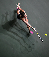 A South Carolina Gamecocks women's tennis player returns the ball during an SEC tournament in Columbia, S.C.  (Travis Bell/SIDELINE CAROLINA)