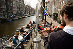 A violinist entertains the patrons at t'Smalle on the Egelantiersgracht in Amsterdam.