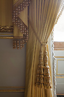 Detail of the long tassels of a curtain tie-back in the drawing room