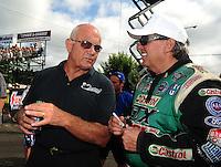 Aug. 7, 2011; Kent, WA, USA; NHRA funny car driver Gary Densham (left) with John Force during the Northwest Nationals at Pacific Raceways. Mandatory Credit: Mark J. Rebilas-