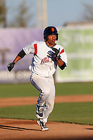 Randy Ortiz #14 of the Salem-Keizer Volcanoes runs the bases during a game against the Tri-City Dust Devils at Volcanoes Stadium on July 27, 2013 in Keizer, Oregon. Tri-City defeated Salem-Keizer, 5-4. (Larry Goren/Four Seam Images)