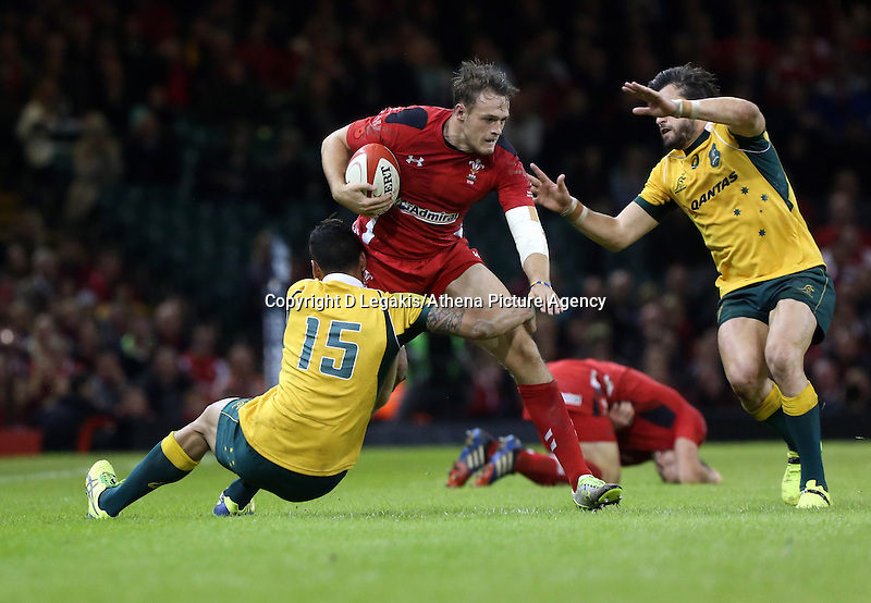 Pictured: of Wales is brought down by Israel Folau (L) and another Australia player. Saturday 08 November 2014<br /> Re: Dove Men Series rugby, Wales v Australia at the Millennium Stadium, Cardiff, south Wales, UK.
