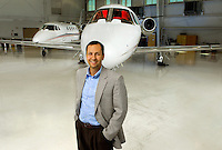 Small business portrait photography of Ryan Stone, CEO of JetPool, an aircraft management, charter and shares firm headquartered at the Charlotte-Douglas International Airport.