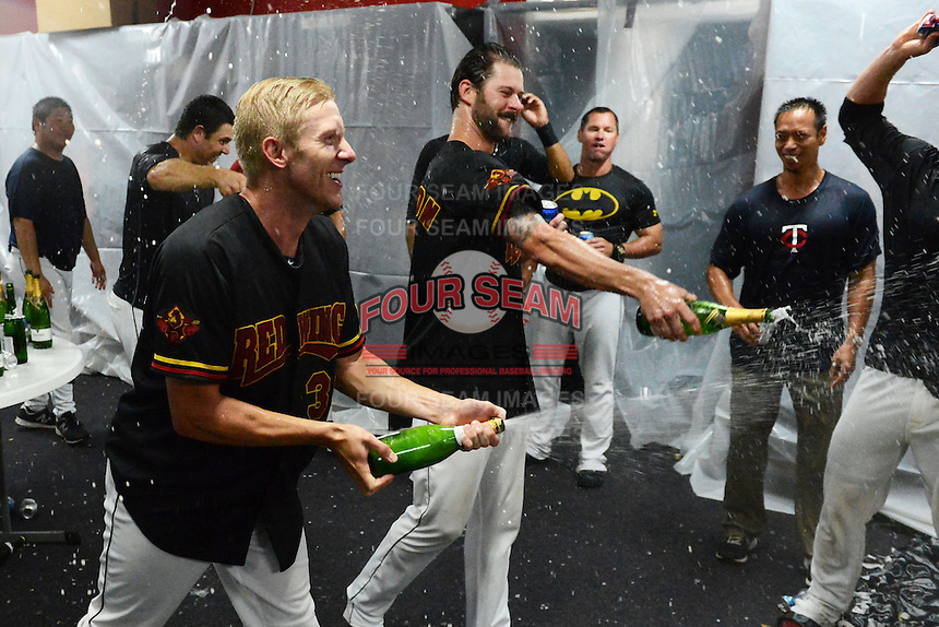 Rochester Red Wings pitchers Cole De Vries and Aaron Thompson celebrates in the locker room after defeating the Scranton Wilkes Barre RailRiders on September 2, 2013 at Frontier Field in Rochester, New York to clinch the International League Wild Card Playoff spot.  (Mike Janes/Four Seam Images)