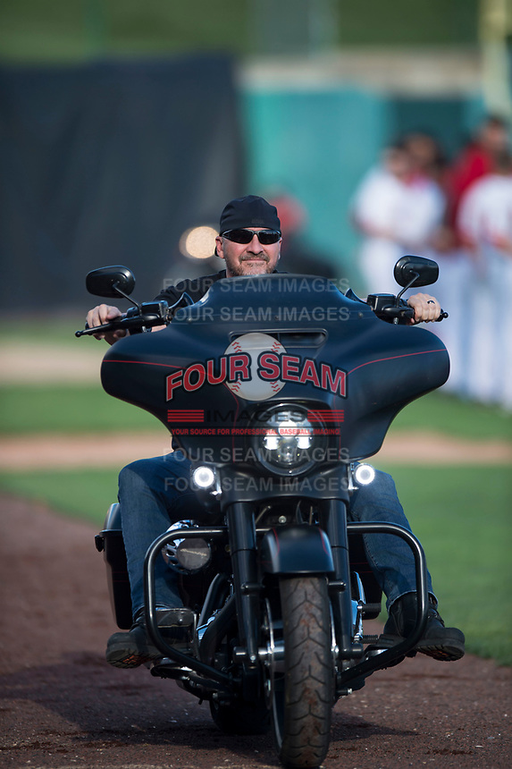 A motorcyclist escorts the American Flag towards home plate before a Pioneer League game between the Orem Owlz and the Ogden Raptors at Home of the OWLZ on August 24, 2018 in Orem, Utah. The Ogden Raptors defeated the Orem Owlz by a score of 13-5. (Zachary Lucy/Four Seam Images)