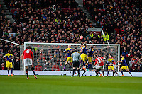 Sunday 05 January 2014<br /> Pictured: Jonny Evans  takes a free kick <br /> Re: Manchester Utd FC v Swansea City FA cup third round match at Old Trafford, Manchester