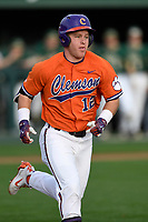 Designated hitter Robert Jolly (12) of the Clemson Tigers runs out a batted ball in a game against the William and Mary Tribe on February 16, 2018, at Doug Kingsmore Stadium in Clemson, South Carolina. Clemson won, 5-4 in 10 innings. (Tom Priddy/Four Seam Images)