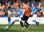 St Johnstone v Dundee United...19.04.14    SPFL<br /> David Wotherspoon is closed down by Andy Robertson<br /> Picture by Graeme Hart.<br /> Copyright Perthshire Picture Agency<br /> Tel: 01738 623350  Mobile: 07990 594431