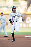 Adam Engel (7) of the Charlotte Knights hustles towards third base against the Durham Bulls at BB&T BallPark on May 15, 2017 in Charlotte, North Carolina. The Knights defeated the Bulls 6-4.  (Brian Westerholt/Four Seam Images)
