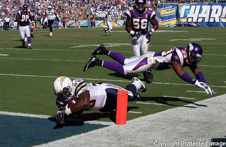 Charger Mike Tobert dives into the endzone for the go-ahead, game winning touchdown in the fourth quarter at Qualcomm Stadium in 2011. Viking Jamarca Sanford, horizontal above him, misses the tackle.  photo for North County Times