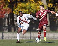 Boston College defender Matt Wendelken (8) works to clear ball as Virginia Tech midfielder Austin Stewart (23) closes.Boston College (maroon) defeated Virginia Tech (Virginia Polytechnic Institute and State University) (white), 3-1, at Newton Campus Field, on November 3, 2013.