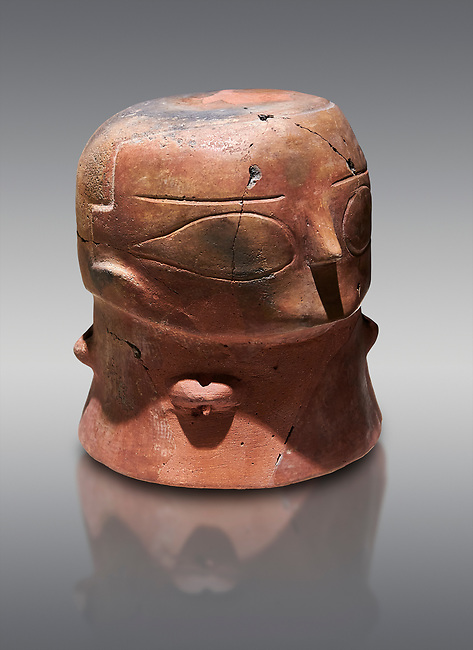 Terracotta Vase with female face. Catalhoyuk Collections. Museum of Anatolian Civilisations, Ankara. Against a grey background